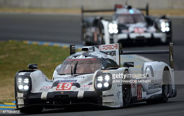 Britany's Nicholas Tandy drives his Porsche 919 Hybrid N°19 ahead of Swiss competitor Neel Jani on his Porsche 919 Hybrid N°18 during the 83rd Le...