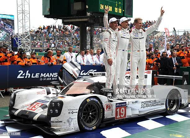 Britany's Nick Tandy New Zealand's Earl Bamber and Germany's Nico Hulkenberg celebrate their victory on his Porsche 919 Hybrid N°19 after winning the...