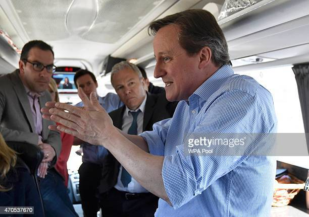Britiain's Prime Minister David Cameron speaks with journalists on the Conservative Party 'battle bus' whilst campaigning in northern England on...