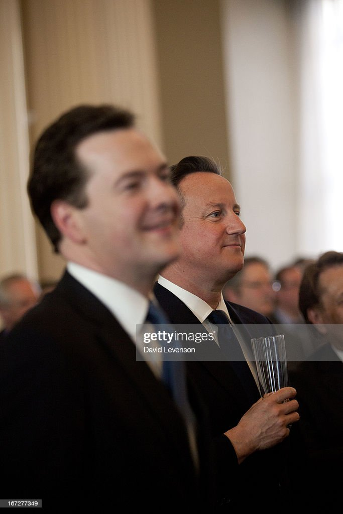 Britian's Chancellor of the Exchequer <a gi-track='captionPersonalityLinkClicked' href=/galleries/search?phrase=George+Osborne&family=editorial&specificpeople=5544226 ng-click='$event.stopPropagation()'>George Osborne</a> and British Prime Minister <a gi-track='captionPersonalityLinkClicked' href=/galleries/search?phrase=David+Cameron+-+Politician&family=editorial&specificpeople=227076 ng-click='$event.stopPropagation()'>David Cameron</a> attend the launch of 'Margaret Thatcher - The Authorised Biography, Volume One: Not for Turning' by Charles Moore at Banqueting House on April 23, 2013 in London, England.