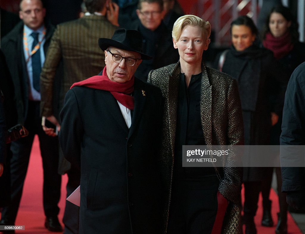British actess Tilda Swinton (R) and festival director Dieter Kosslick arrive for the 'Tribute to David Bowie: The Man Who Fell to Earth' screening event on the sidelines of the Berlinale film festival inBerlin on February 12, 2016. / AFP / dpa / Kay Nietfeld / Germany OUT