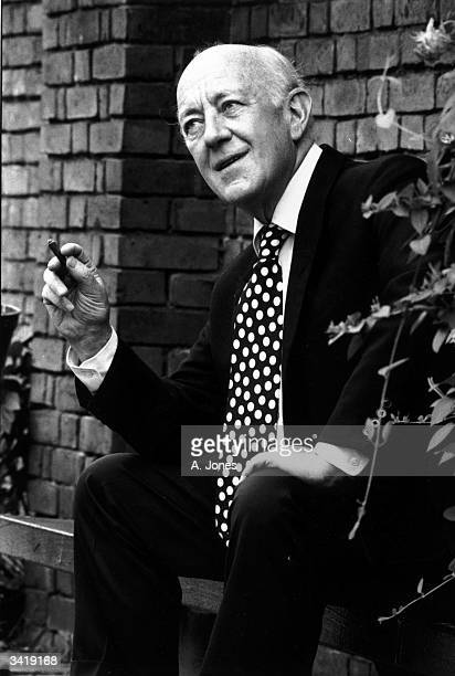 British actor Alec Guinness wearing a spotty tie