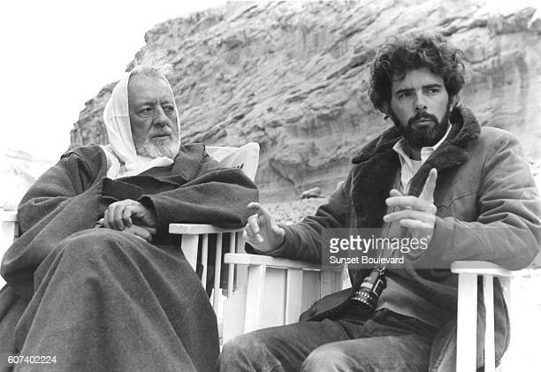 British actor Alec Guinness with American director screenwriter and producer George Lucas on the set of his movie Star Wars Episode IV A New Hope