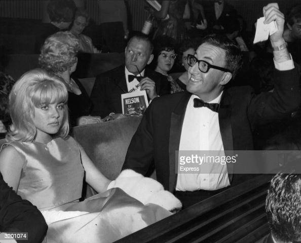 British actor and comedian Peter Sellers and American actor Sue Lyon attend the premiere of director Stanley Kubrick's film 'Lolita' in which they...