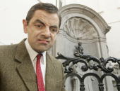 British actor and comedian Rowan Atkinson known for his character 'Mr Bean' poses at the MannekenPis on March 14 2007 in Brussels Belgium