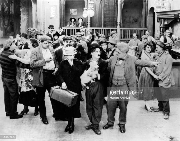 British actor and director Charlie Chaplin stars in the comedy 'A Dog's Life' directed by himself for First National