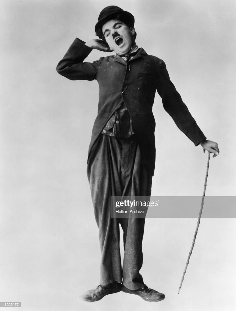 British actor and director <a gi-track='captionPersonalityLinkClicked' href=/galleries/search?phrase=Charlie+Chaplin&family=editorial&specificpeople=70006 ng-click='$event.stopPropagation()'>Charlie Chaplin</a> (1889 - 1977) stretches and yawns in a full-length promotional portrait for his film 'The Tramp'.