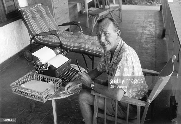 British actor and playwright Noel Coward working at 'Firefly' his home at Roundhill Jamaica