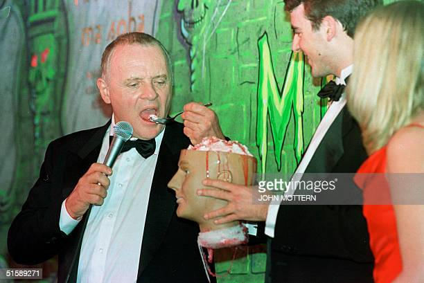 British actor Anthony Hopkins has a bite to eat during a roasting in his honor with seniors Ben Forkner and Suzanne Pomey after being named Man of...