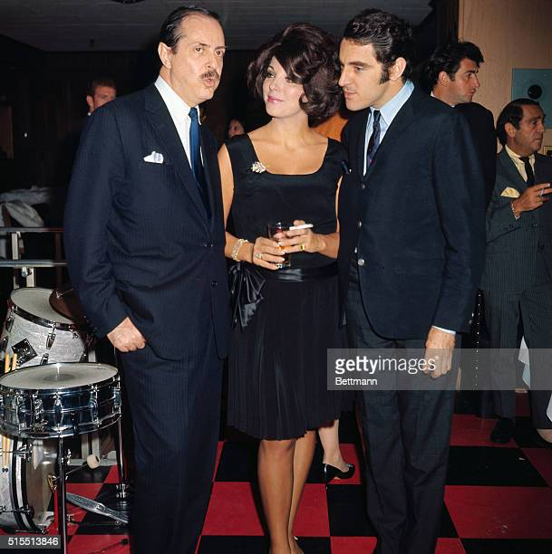 British actor Anthony Newley and his lovely wife Joan Collins visit with producer David Merrick at Danny's hideaway September 24th The occasion was a...