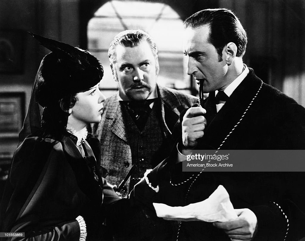 British actor <a gi-track='captionPersonalityLinkClicked' href=/galleries/search?phrase=Basil+Rathbone&family=editorial&specificpeople=93122 ng-click='$event.stopPropagation()'>Basil Rathbone</a> (1892 - 1967) as fictional detective Sherlock Holmes with <a gi-track='captionPersonalityLinkClicked' href=/galleries/search?phrase=Nigel+Bruce&family=editorial&specificpeople=1073756 ng-click='$event.stopPropagation()'>Nigel Bruce</a> (1895 - 1953) as Doctor Watson in 'The Adventures of Sherlock Holmes', 1939. Actress <a gi-track='captionPersonalityLinkClicked' href=/galleries/search?phrase=Ida+Lupino&family=editorial&specificpeople=214077 ng-click='$event.stopPropagation()'>Ida Lupino</a> (1918 - 1995) is on the left.