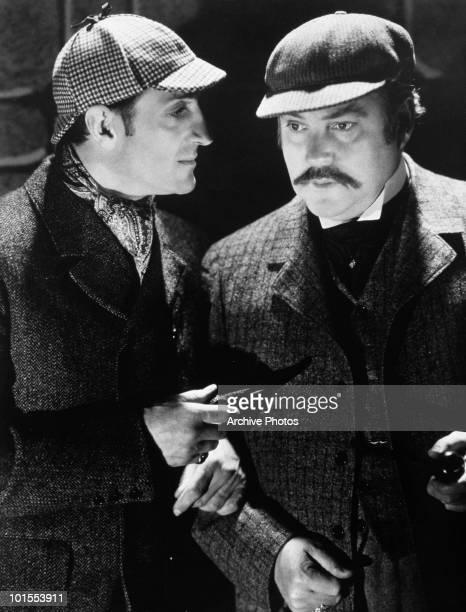 British actor Basil Rathbone as fictional detective Sherlock Holmes with Nigel Bruce as Doctor Watson circa 1939