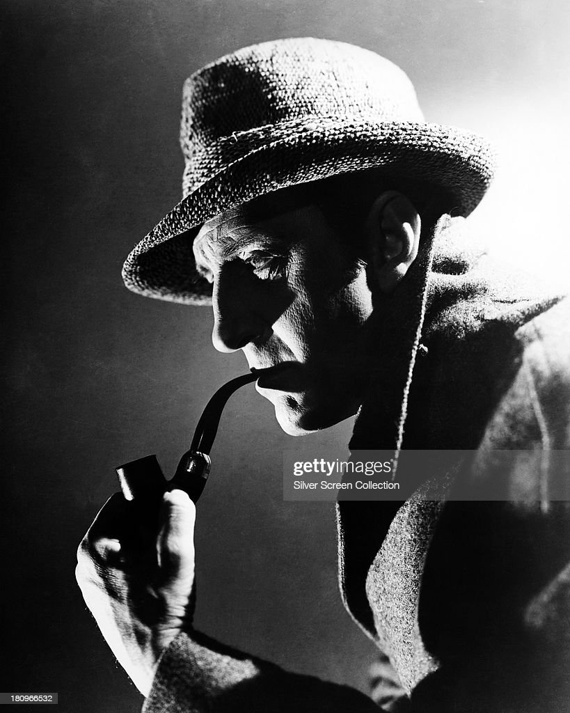 British actor <a gi-track='captionPersonalityLinkClicked' href=/galleries/search?phrase=Basil+Rathbone&family=editorial&specificpeople=93122 ng-click='$event.stopPropagation()'>Basil Rathbone</a> (1892 - 1967) as Sherlock Holmes in a promotional portrait, circa 1944. The image was used in posters for 'The Pearl Of Death' (1944) and 'Pursuit To Algiers' the following year.