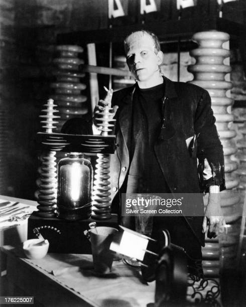 British actor Boris Karloff smokes a cigarette while in costume as The Monster on the set of 'Frankenstein' directed by James Whale 1931