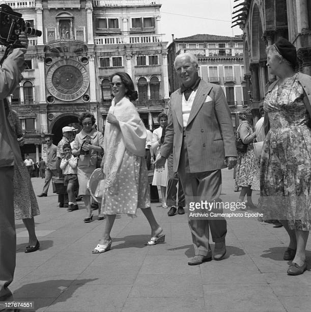British actor Charlie Chaplin with Oona O'Neill in St Mark Square Venice 1959