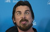 British actor Christian Bale makes a face during a photocall for the film 'American Hustle' in the Berlinale Special category at the 64rd Berlinale...