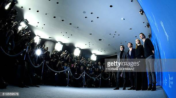 TOPSHOT British actor Colin Firth British actor Jude Law American actress Laura Linney and AngloAustralian actor Guy Pearce attend a photo call for...