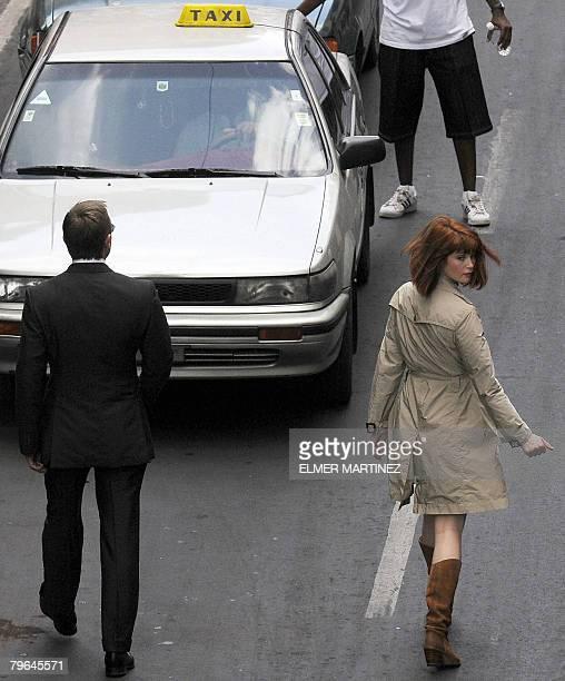 British actor Daniel Craig and Ukrainianborn actress Olga Kurylenko head towards a taxi during the shooting of James Bond's last movie 'Quantum of...