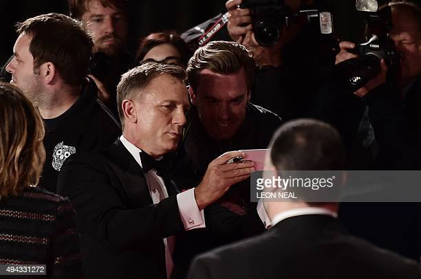 British actor Daniel Craig poses for a selfie with fans on arrival for the world premiere of the new James Bond film 'Spectre' at the Royal Albert...