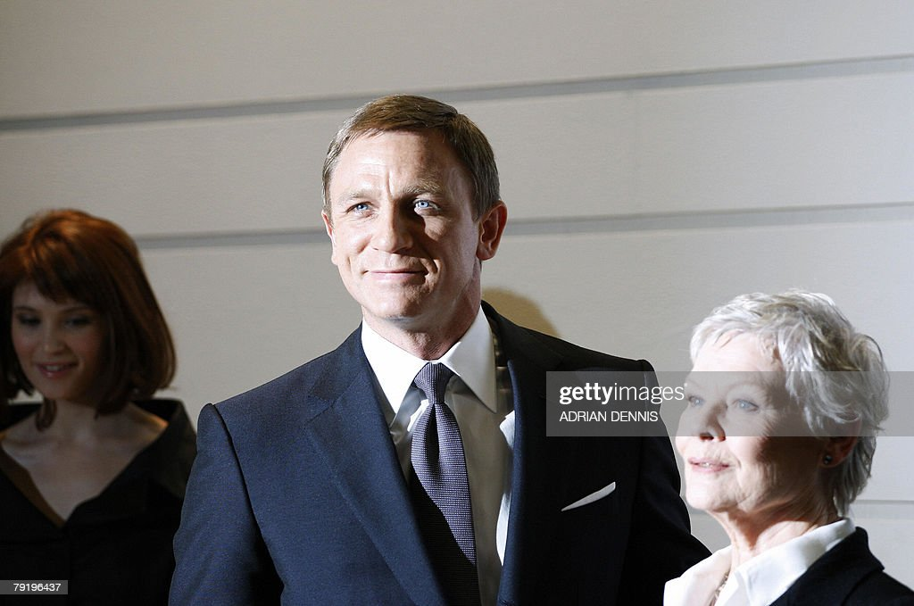British actor Daniel Craig (C) poses with British actresses Dame Judi Dench (R) and Gemma Arterton during a photocall to celebrate the start of production of the latest James Bond movie 'Quantum of Solace' at Pinewood Studios in Iver Heath, Buckinghamshire, 24 January 2008. Eon productions and Sony Pictures are producing the 22nd James Bond adventure film where Bond is on a mission that leads him to Austria, Italy and South America .