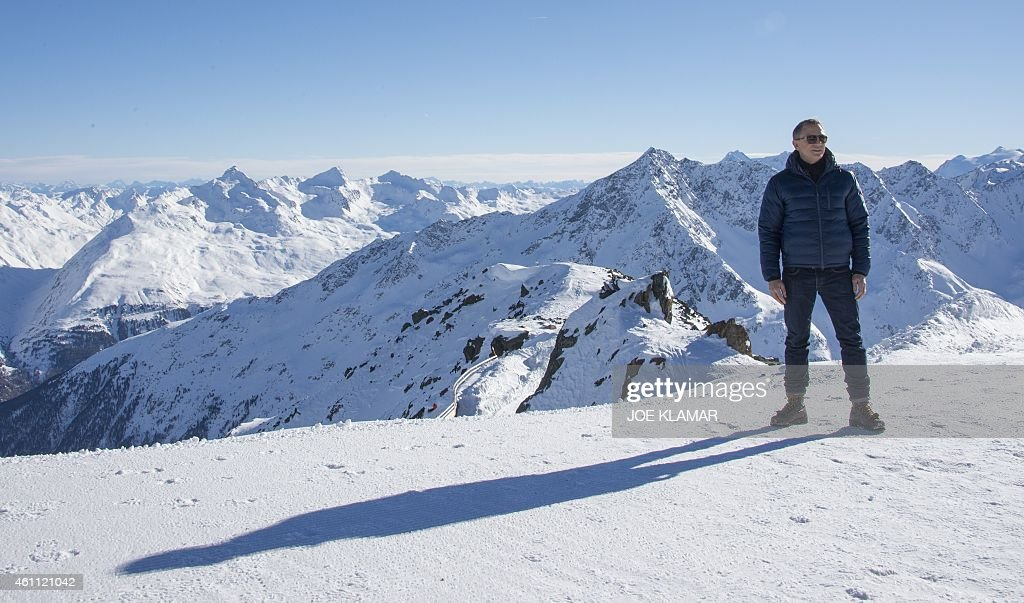 British actor Daniel Craig poses with Tyrolean Alps in the background during a photo call of the new James Bond film 'SPECTRE' in Austrian ski resort...