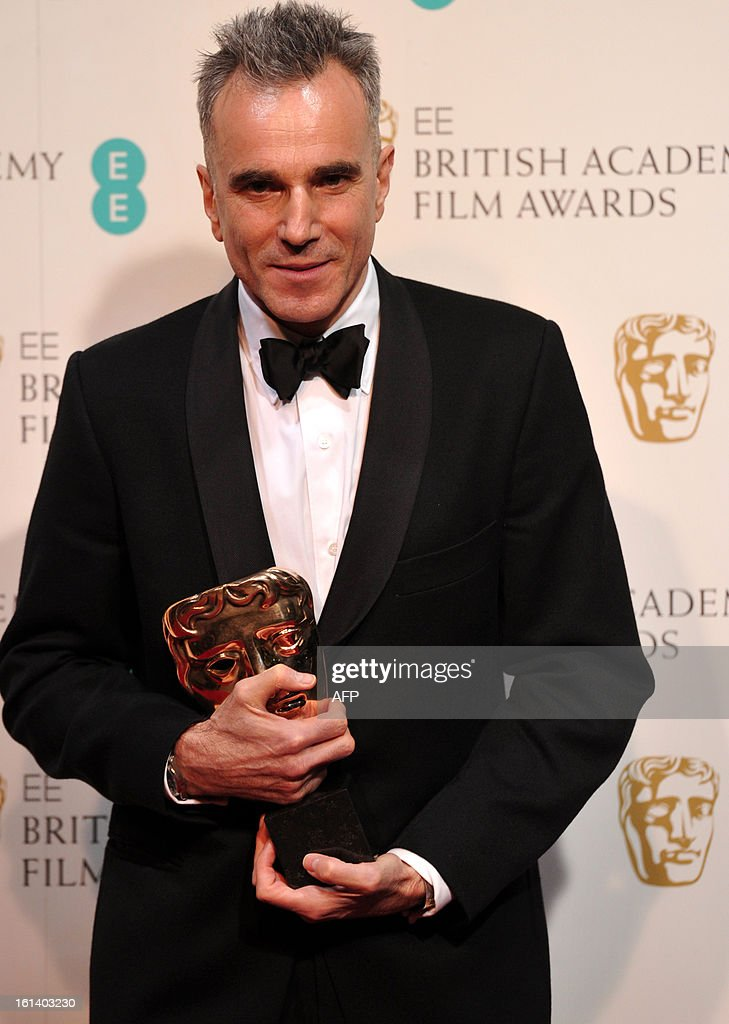British actor Daniel Day-Lewis poses with the award for best leading actor for his performance in the film Lincoln during the annual BAFTA British Academy Film Awards at the Royal Opera House in London on February 10, 2013. AFP PHOTO/Carl COURT