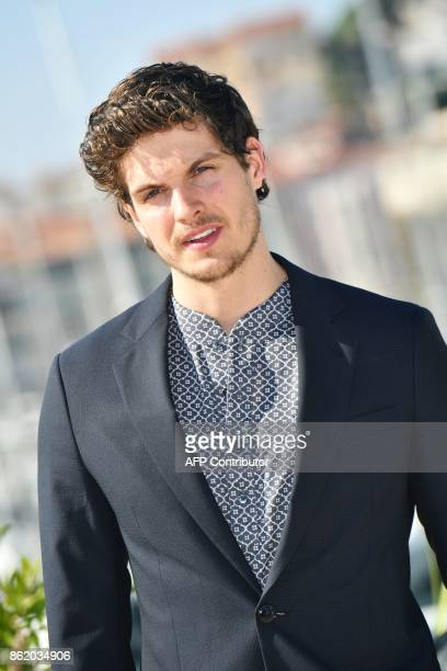 British actor Daniel Sharman poses during the MIPCOM trade show in Cannes southern France on October 16 2017 / AFP PHOTO / YANN COATSALIOU