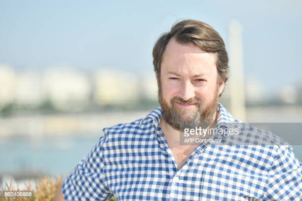 British actor David Mitchell poses during the MIPCOM trade show in Cannes southern France on October 17 2017 / AFP PHOTO / YANN COATSALIOU