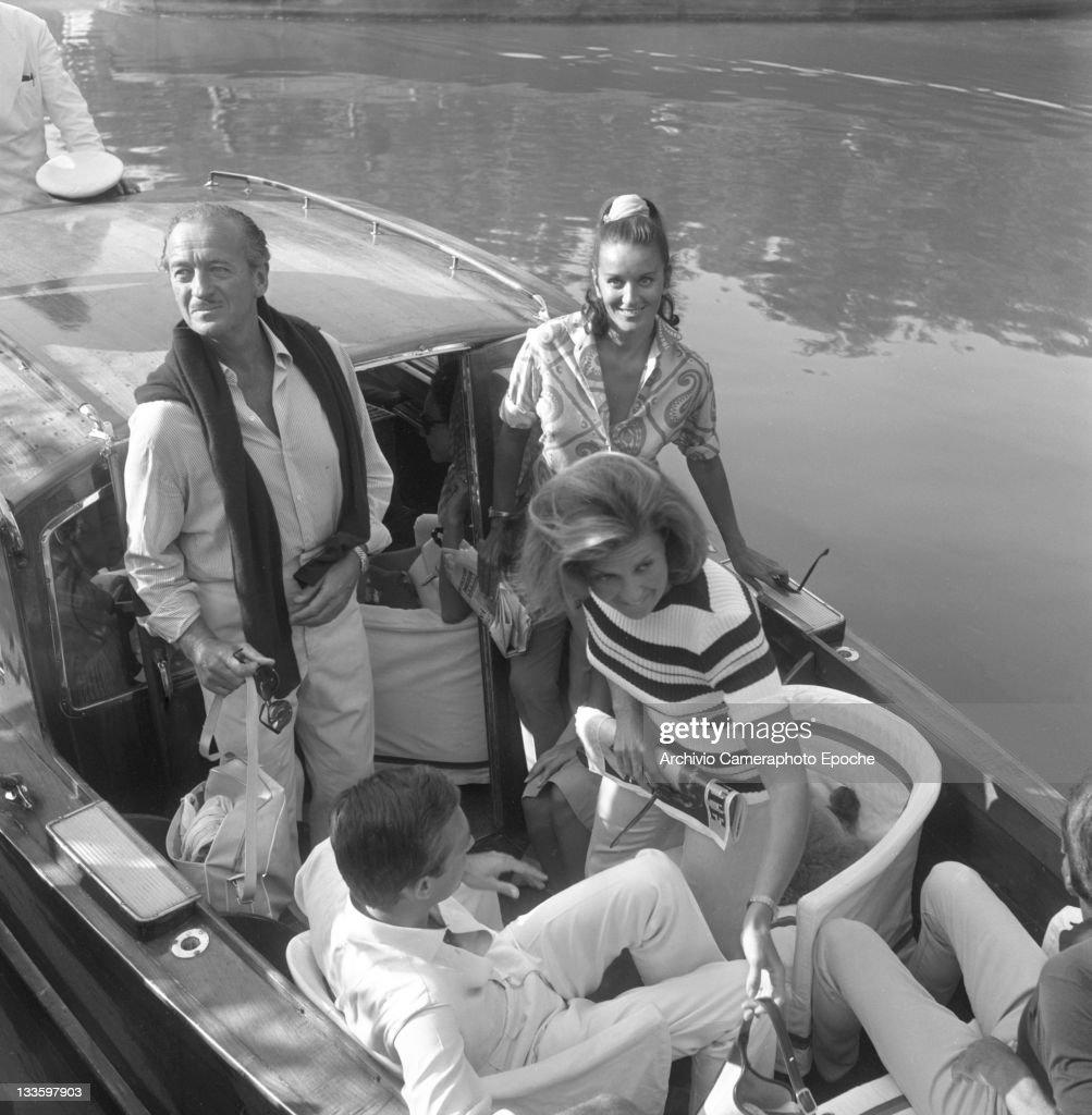 British actor <a gi-track='captionPersonalityLinkClicked' href=/galleries/search?phrase=David+Niven&family=editorial&specificpeople=123835 ng-click='$event.stopPropagation()'>David Niven</a> portrayed on a water taxi at Lido, Venice, 1970s.