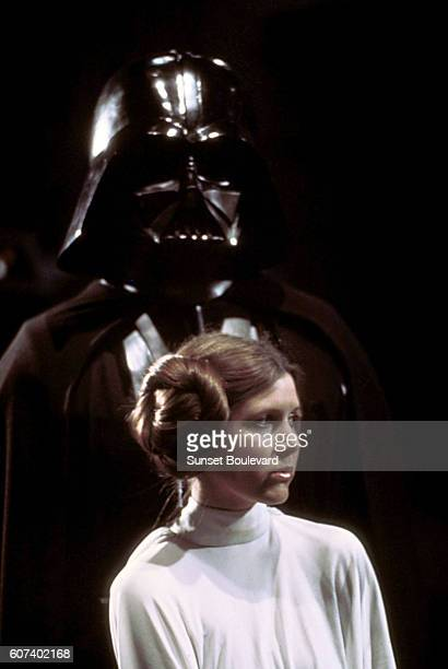 British actor David Prowse and American actress Carrie Fisher on the set of Star Wars Episode IV A New Hope written directed and produced by Georges...