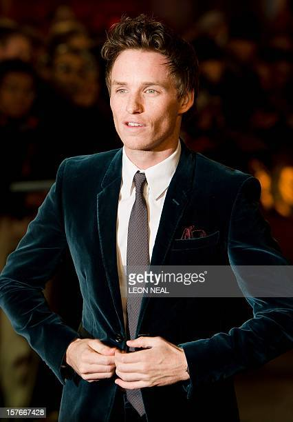 British actor Eddie Redmayne poses for photographers on the red carpet ahead of the world premiere of 'Les Miserables' in central London on December...