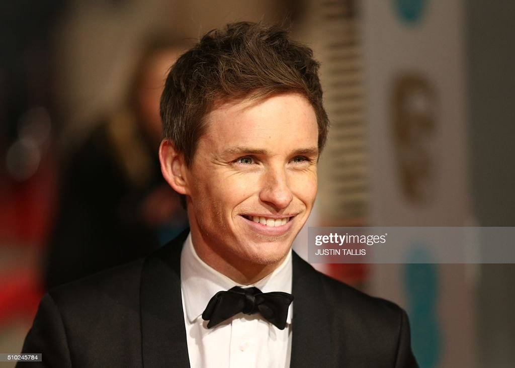 British actor Eddie Redmayne poses on arrival for the BAFTA British Academy Film Awards at the Royal Opera House in London on February 14, 2016. TALLIS