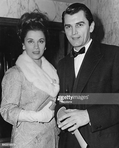 British actor Edmund Purdom with his exwife actress Linda Christian at the premiere of the film 'The Yellow RollsRoyce' at the Empire Leicester...