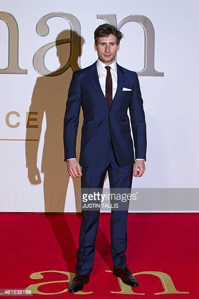 British actor Edward Holcroft poses for pictures on the red carpet as he arrives to attend the world premier of 'Kingsman The Secret Service' in...