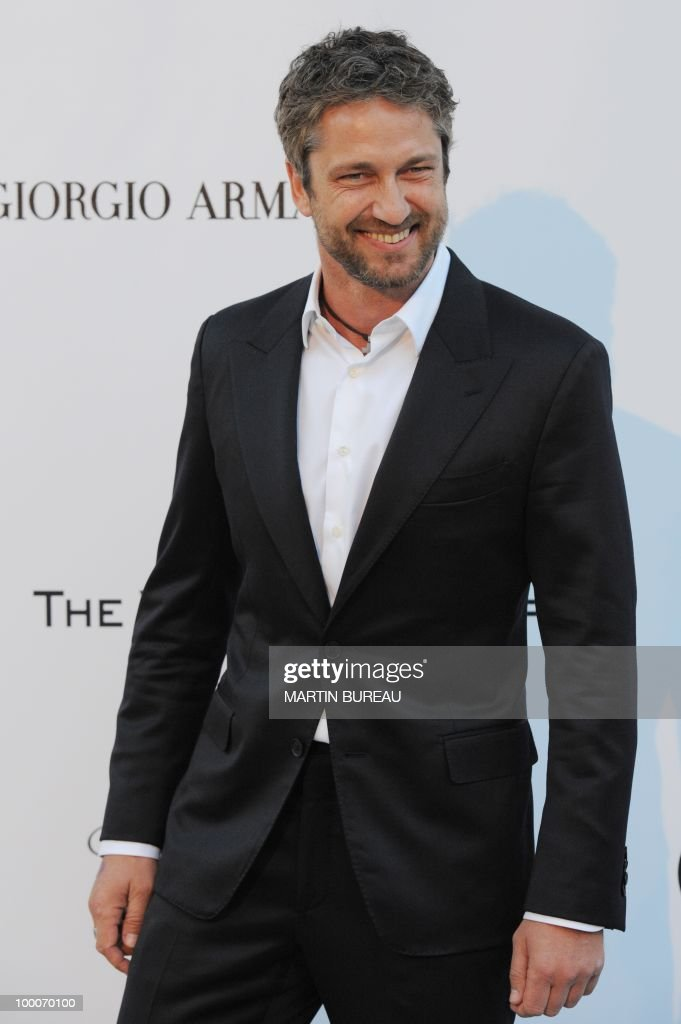 British actor Gerard Butler poses while arriving at amfAR's Cinema Against Aids 2010 benefit gala on May 20, 2010 in Antibes, southeastern France.