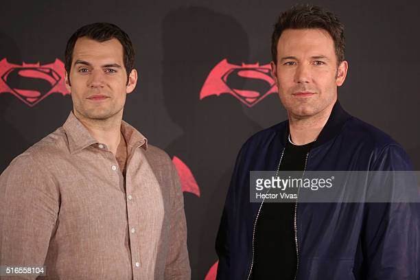 British actor Henry Cavill American actor Ben Affleck pose for pictures during the Batman v Superman Movie photocall at St Regis Hotel on March 19...