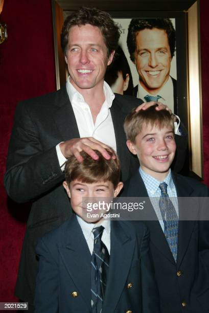 British actor Hugh Grant poses with his nephews at the New York Premiere of the film 'Two Weeks Notice' at The Ziegfeld Theatre New York City...