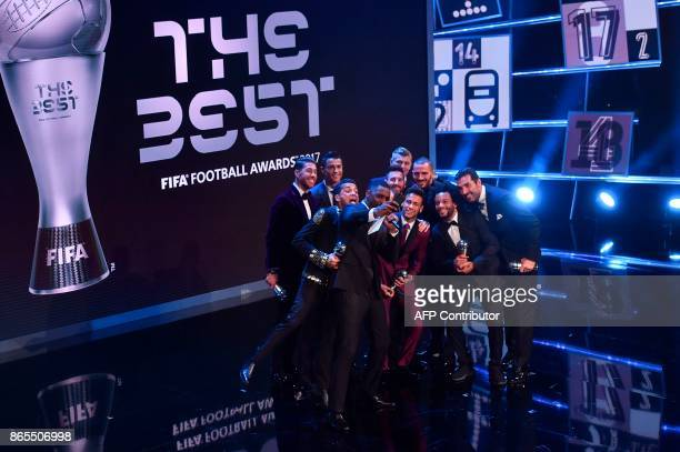 British actor Idris Elba acting as host poses for a selfie photograph with Real Madrid and Portugal forward Cristiano Ronaldo Barcelona and Argentina...