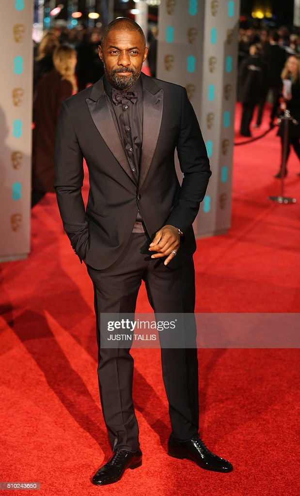 British actor Idris Elba poses on arrival for the BAFTA British Academy Film Awards at the Royal Opera House in London on February 14, 2016. TALLIS