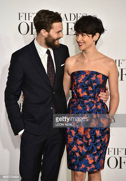 British actor Jamie Dornan and his wife Amelia Warner pose for photographers ahead of the UK Premiere of 'Fifty Shades of Grey' in central London on...