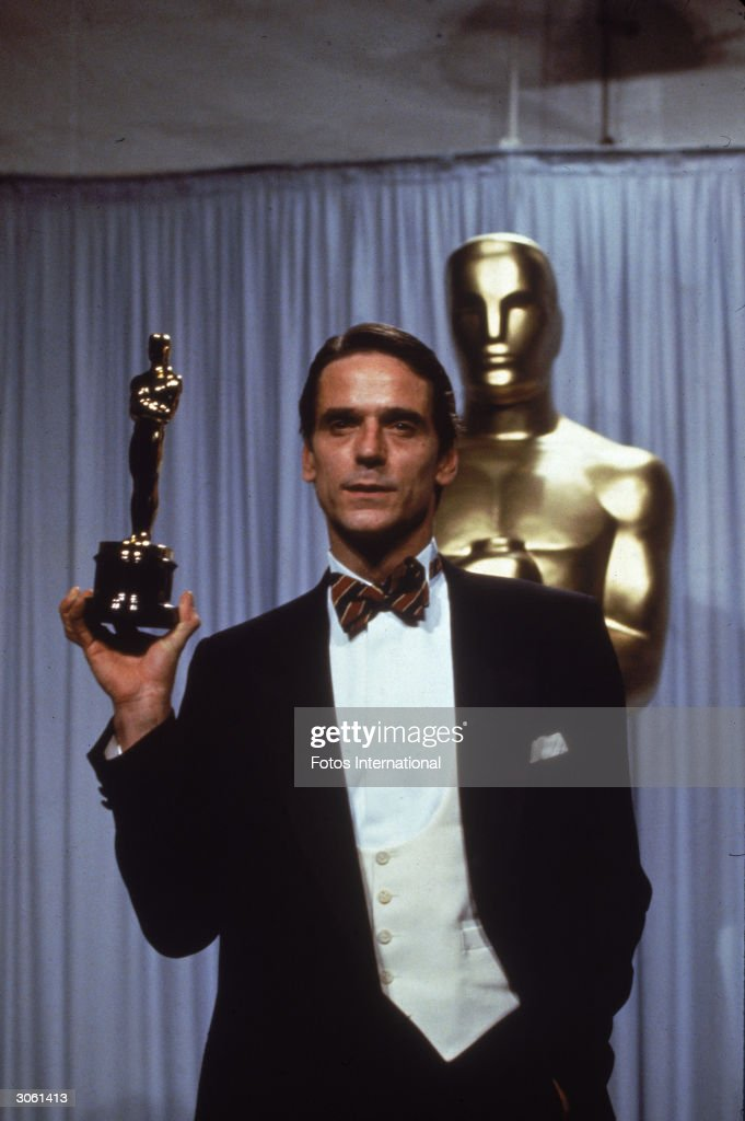 British actor Jeremy Irons holds his Best Actor Oscar statuette which he received for his role in the film, 'Reversal of Fortune,' directed by Barbet Schroeder, at the Academy Awards, Los Angeles, California, March 25, 1991.