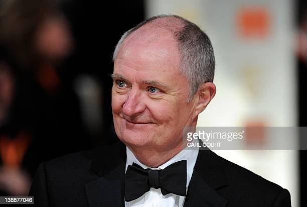 British actor Jim Broadbent poses on the red carpet arriving at the BAFTA British Academy Film Awards at the Royal Opera House in London on February...