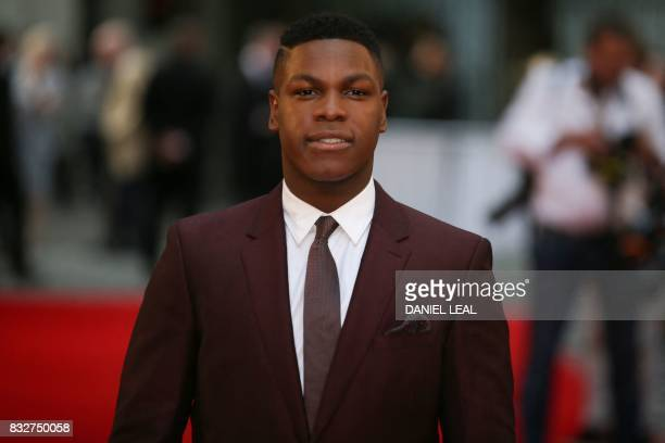 British actor John Boyega poses for a photograph upon arrival at the European premiere of 'Detroit' in London on August 16 2017 / AFP PHOTO / Daniel...