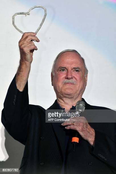 British actor John Cleese poses with the 'Honorary Heart Of Sarajevo' award for his 'extraordinary contribution' to film during the 23rd Sarajevo...