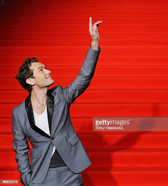British actor Jude Law waves to Japanese fans on the red carpet before the Japan premiere of the film 'Sherlock Holmes' in Tokyo on February 18 2010...