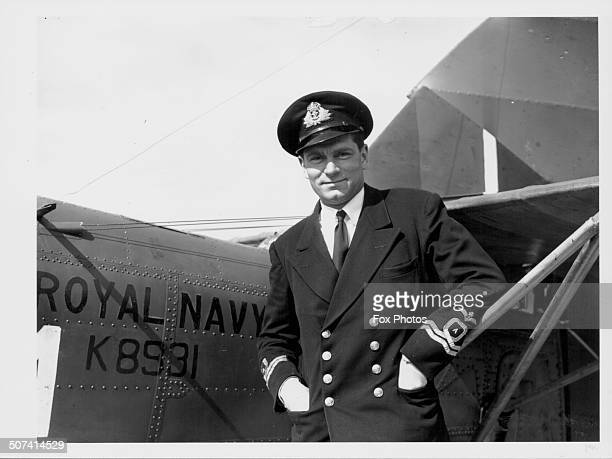 British actor Laurence Olivier standing next to a Albacore aircraft at a Fleet Air Arm Station during World War Two August 17th 1942