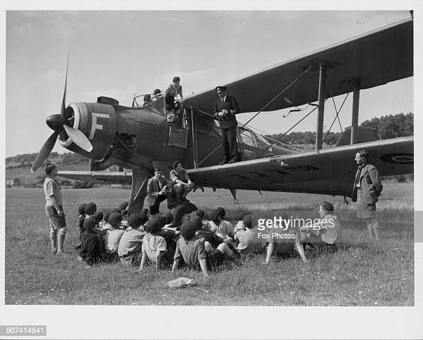 British actor Laurence Olivier standing on the wing of a Albacore aircraft and talking to a group of scouts at a Fleet Air Arm Station during World...