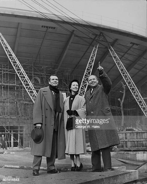 British actor Laurence Olivier with his actress wife Vivien Leigh visiting the site of the Festival of Britain with Mr Gerald Fox on the South Bank...