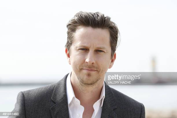 British actor Lee Ingleby poses for the photocall of the TV series 'The Five' at the MIPCOM audiovisual trade fair in Cannes southeastern France on...