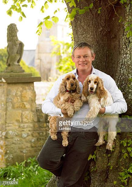 British actor Martin Clunes with his pet dogs Mary Elizabeth and Tina Audrey at home in Dorset on 12th May 2005